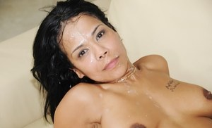 Busty Asian MILF Jaya Storm parks her horny snatch atop a cock in knee socks
