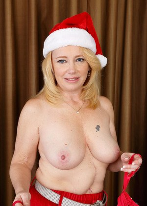 Plump older lady Brandie Sweet takes off her cute Xmas outfit to bare her twat