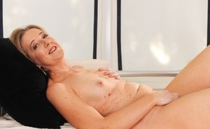 Petite granny Meryl Strip tries her hand at showing off her pussy in the nude