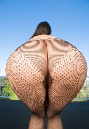 Hot solo model Valentina Nappi works her sexy ass clear of mesh pantyhose