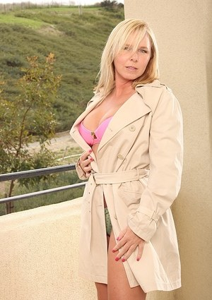 Hot older blonde Lacey Love undresses for pussy play on the balcony