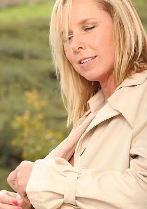 Mature blonde woman Lacey Love flashes her tits and twat wearing an overcoat