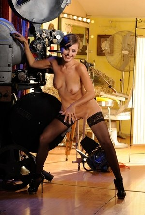 Classy MILF Silvia Bianco strips to black stockings for nude modeling job