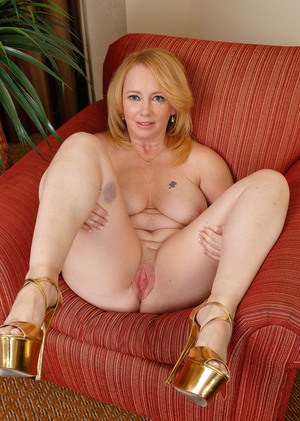 Chubby mature broad Brandie Sweet spreads her pink and creamy vagina up close