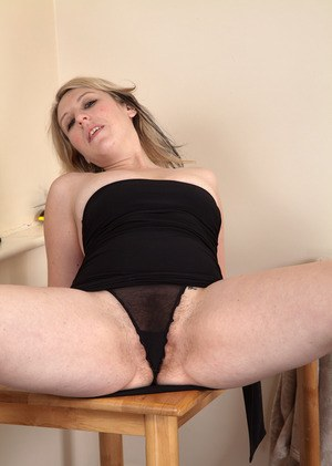 Older lady Mel Harper slips out of her black dress and undies to show her bush