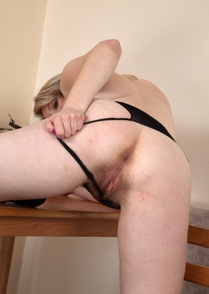 Older solo model Mel Harper uncovers her big tits first and then her beaver