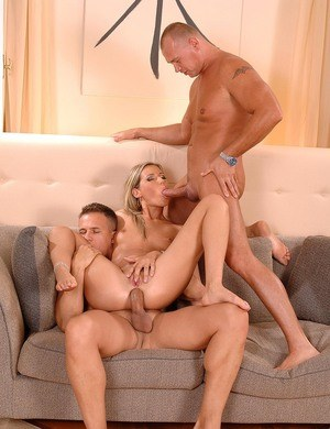 Sexy pornstar Cherry Jul gets butt fucked by two guys in a MMF threesome