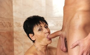 Nude grandmother gets down and gives her step-grandson his first BJ in shower