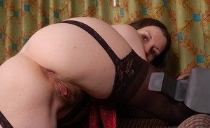 Brunette mom Shanti shows off her neatly trimmed bush in black stockings