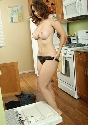Older MILF Mandy Sweet unleashes her big tits while doing the dishes