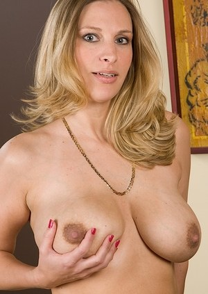 Busty MILF Bailyn Stephens undresses to reveal her pierced pussy