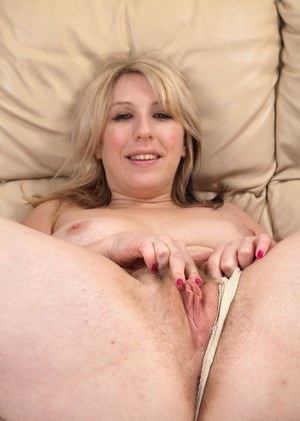 Sexy older lady Mel Harper slips off spandex pants to best show her hairy twat