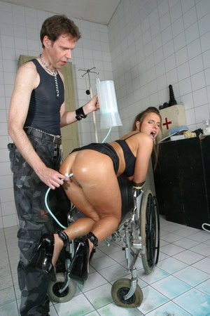Kinky couple play water sport and anal games in a wheelchair in hospital