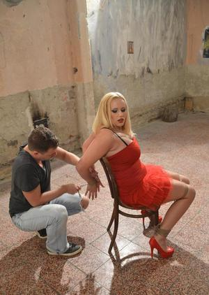 Blonde female Vicky is left to struggle after being tied to a chair with rope