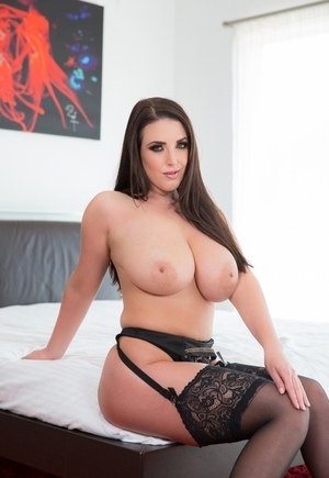 Solo girl Angela White flaunts her big natural tits and juicy ass in stockings