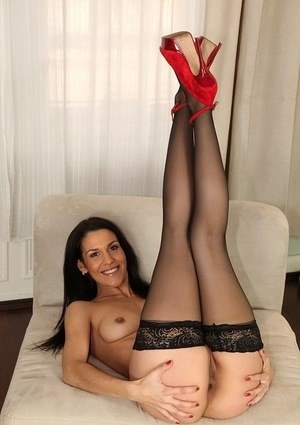 Brunette model Samia Duarte strips to black stockings matched with red heels
