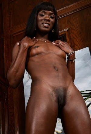 Ebony chick Ana Foxxx slips off her yoga clothes to show off her pink pussy