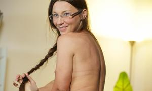 Petite chick Julie Skyhigh undresses teasingly while wearing glasses