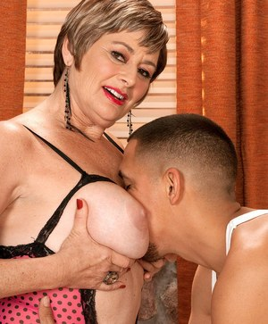 Short haired older lady Victoria Peale seduces her boarder on the sofa