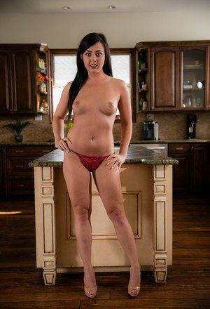 Brunette chick Whitney Wright flashes her butt cheeks and disrobes in kitchen