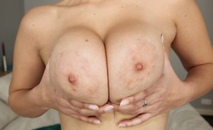 Amateur chick Chrissy uncovers her nice all natural tits while undressing
