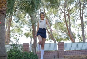 Teen girl Lilly Ford heads outdoors in a short skirt for a flashing session