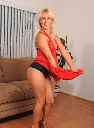 Mature blonde lady Andi Roxxx teases in a red dress before masturbating