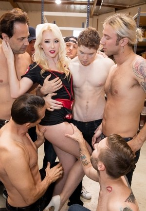 Tiny blonde slut Samantha Rone gets on her knees to sucks a lot of big dicks