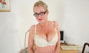 Older office worker Jade strips to her knickers and glasses on her lunch break