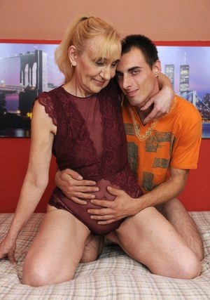 Blonde grandmother Nanney gives her step-grandson his early sex lessons