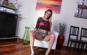 Young beauty Kendra Lynn shows her trimmed bush previously hidden up her skirt