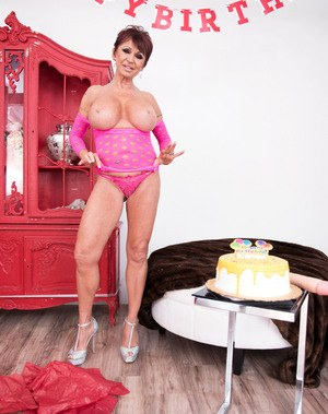 Short haired granny Gina Milano plays with a huge dildo on her birthday