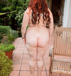 Older BBW Roxee Robinson strips naked on the pathway outside her house