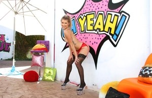 Solo model Arya Fae flashes what she has in black stockings afore graffiti
