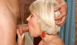 Mature lady seduces the neighbour's boy and introduces him to anal sex