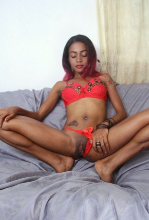 Black amateur Sisay exposes her pink pussy with her bare legs spread open