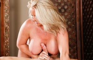 Mature blonde masseuse Maya Devine takes care of her clients hard on
