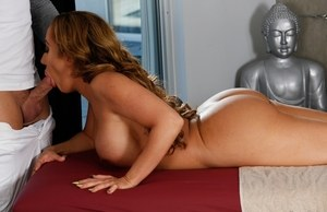 Nude MILF Richelle Ryan sucks off her masseur as she lies naked on table