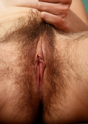 Middle-aged lady Kristina exposes her unshaven armpits and pussy