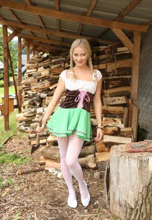 Hot blonde teen Cayla A pulls down white hose to masturbate next to wood pile