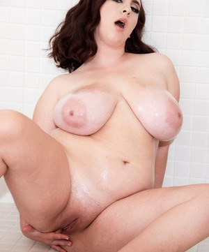 BBW Milly Marks whips out her huge tits before solo masturbation in the shower