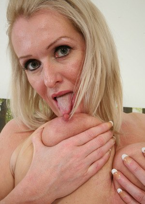 Mature blonde Jade whips out her big natural tits prior to fingering herself