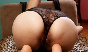 Hot mature woman Kristina bares her hairy muff as she sheds her lingerie