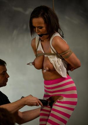 Restrained female Linet Slag finds herself being forcibly masturbated