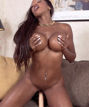 Busty black MILF Diamond pleases her horny pussy with a couple of sex toys