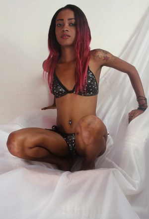 Tiny black amateur Sisay uncovers her petite tits before showing her pink twta