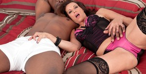 Aged lady Mimi Moore sucks off a BBC wearing black stockings and sexy lingerie