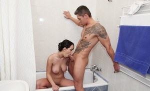 First timer Naomi lets her big tits hang free while giving a BJ in the bathtub
