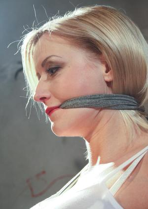 Tied and gagged female has her big tits and erect nipples exposed for her