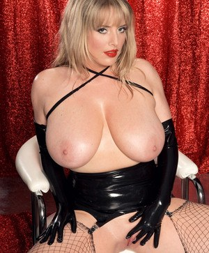 Blonde BBW Maggie Green struts her stuff in stripper boots and mesh stockings